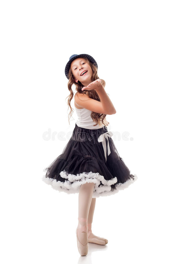 Cute young ballerina sends air kiss to camera stock photo