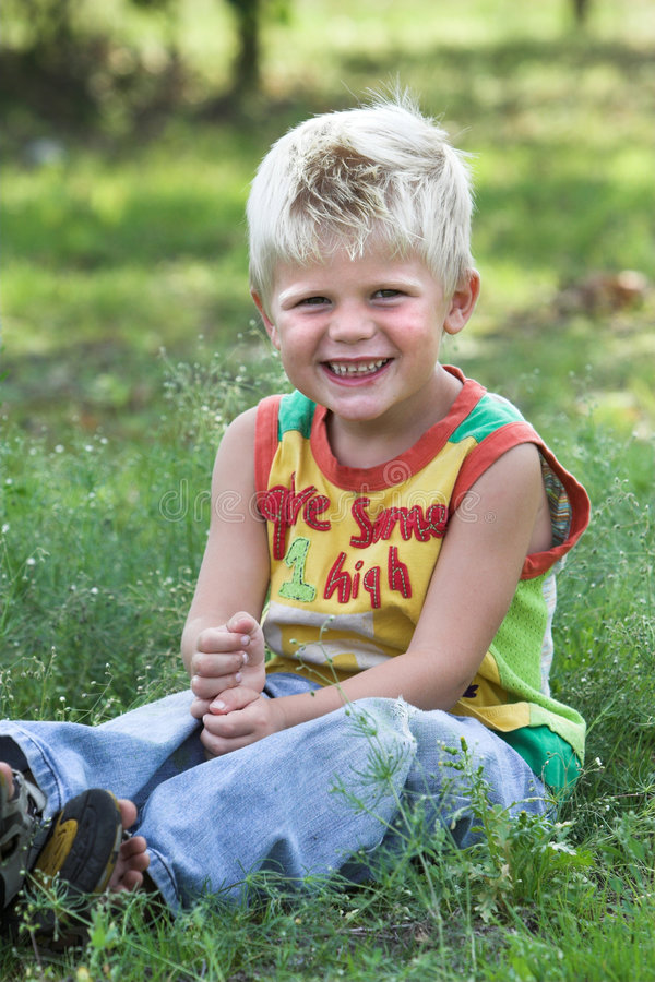 Cute young blond kid stock image