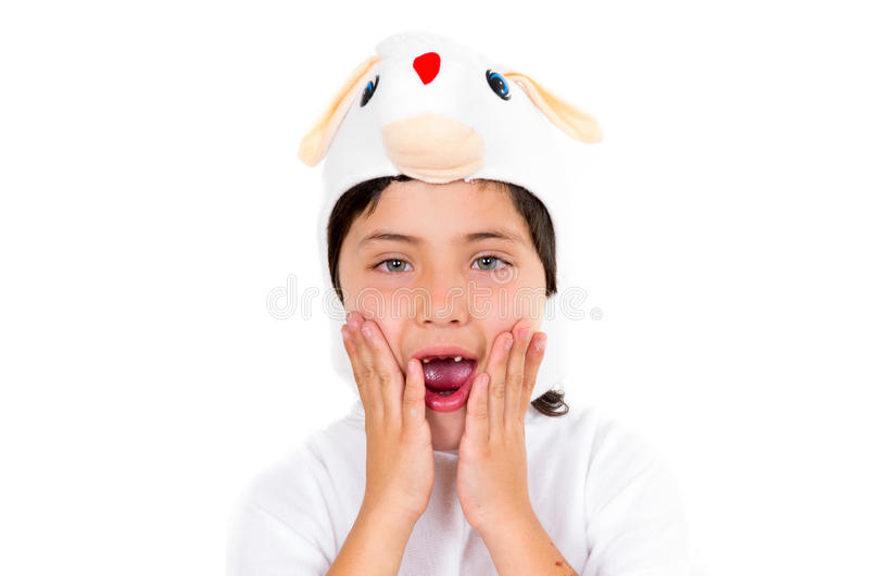 Cute young boy dressed in bunny costume making. Adorable faces isolated over white background royalty free stock images