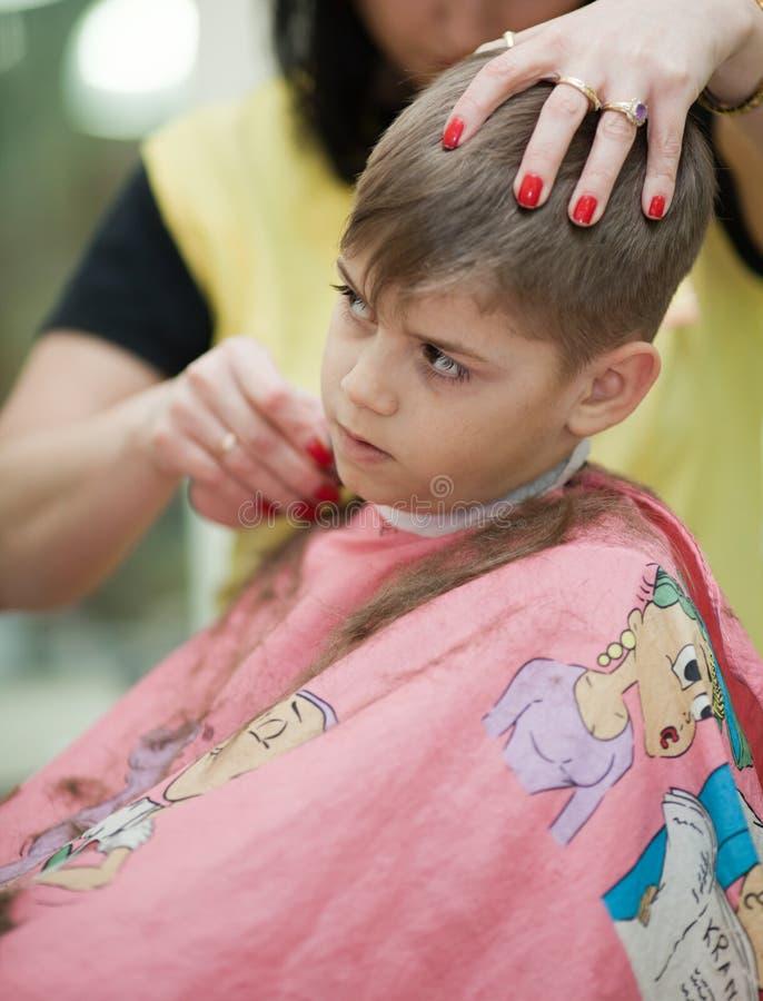 Download Cute Young Boy Getting Haircut Stock Photo