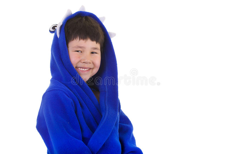 Cute young boy with great smile in bath robe stock image