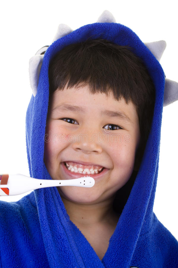 Cute young boy with great smile brushing teeth royalty free stock photos