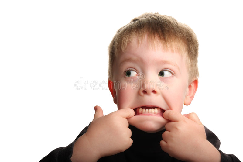 Cute young boy making funny face stock images