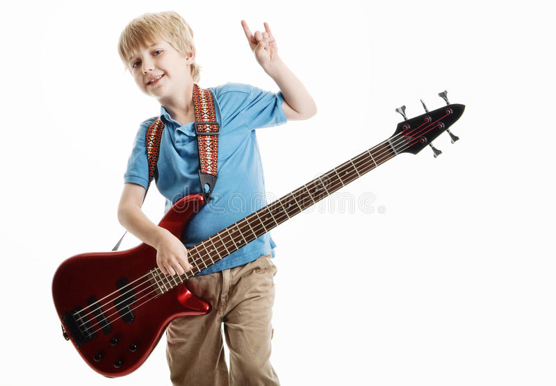 Cute young boy playing an electric guitar royalty free stock photography