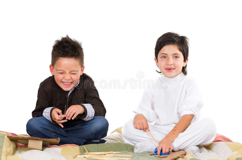Cute young boys playing together isolated over. White background stock photo