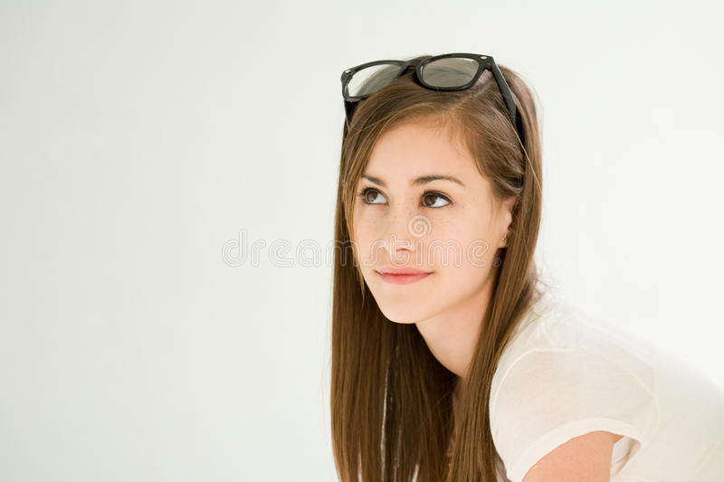 Cute young brunette girl pondering. stock image