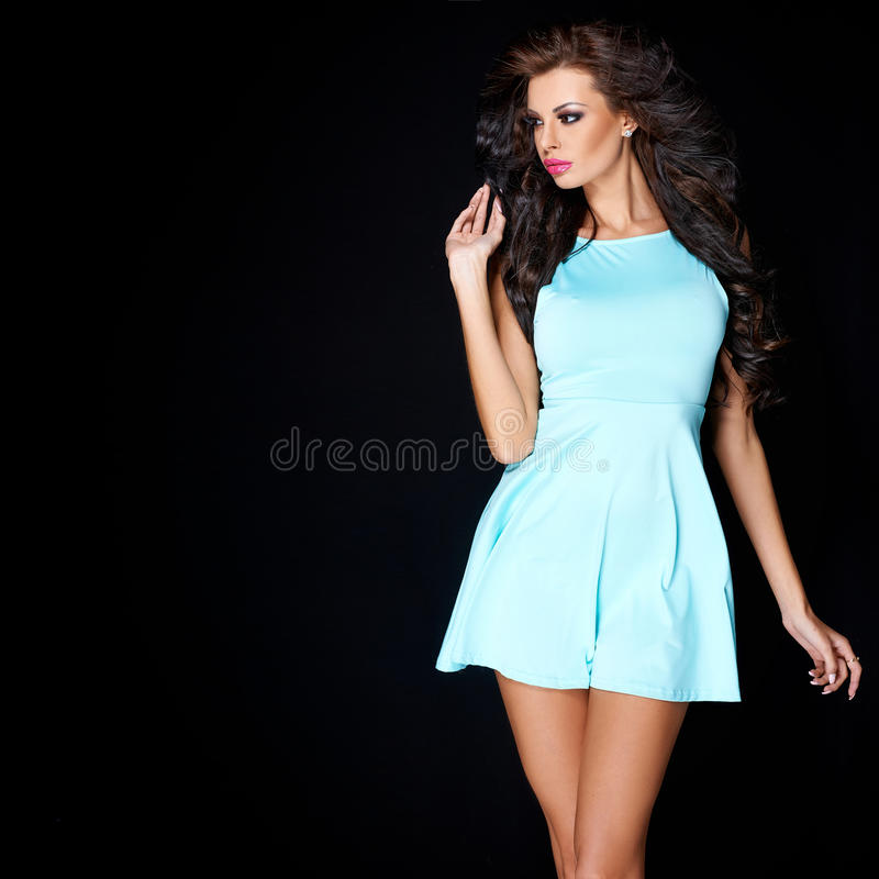 Download Cute Young Brunette Posing In Blue Dress Stock Photo - Image: 42949503