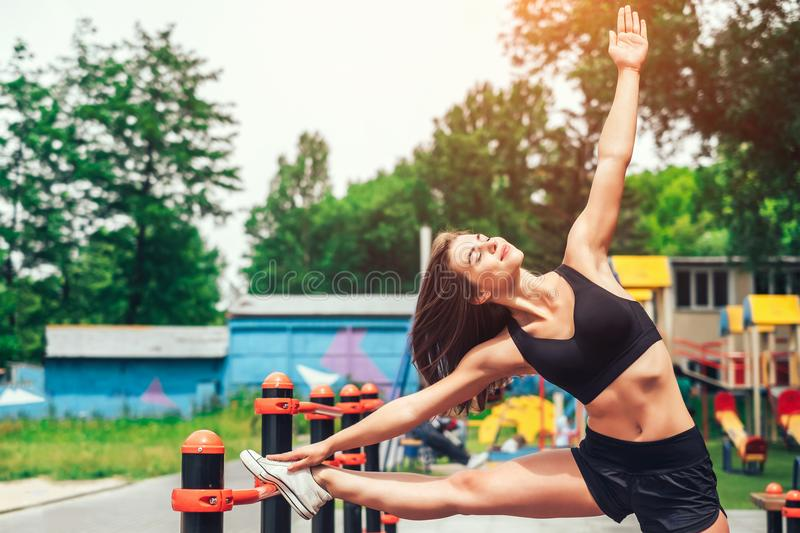 Cute young brunette sporty girl workout outdoor royalty free stock images