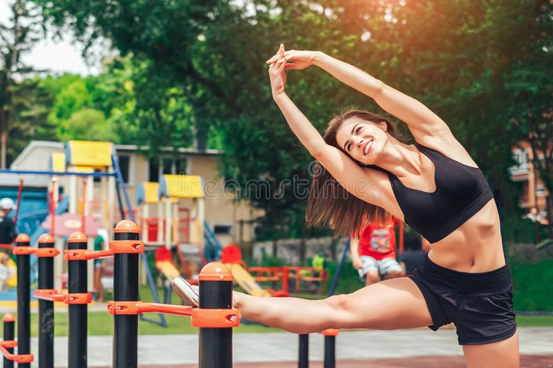 Cute young brunette sporty girl workout outdoor royalty free stock image