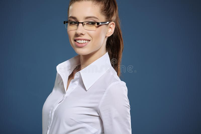 Cute young business woman with glasses royalty free stock photos