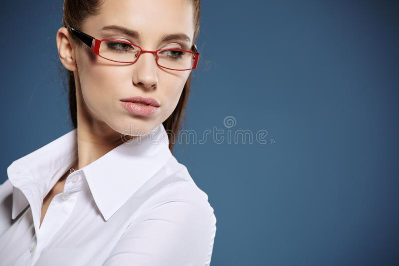 Cute young business woman with glasses stock image