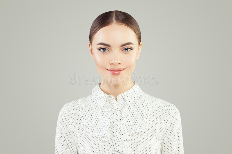 Cute young business woman portrait. Smart businesswoman in white shirt stock photo