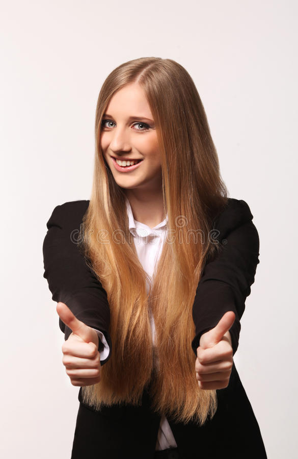 Cute young business woman. Showing thumbs up isolated in white background stock images