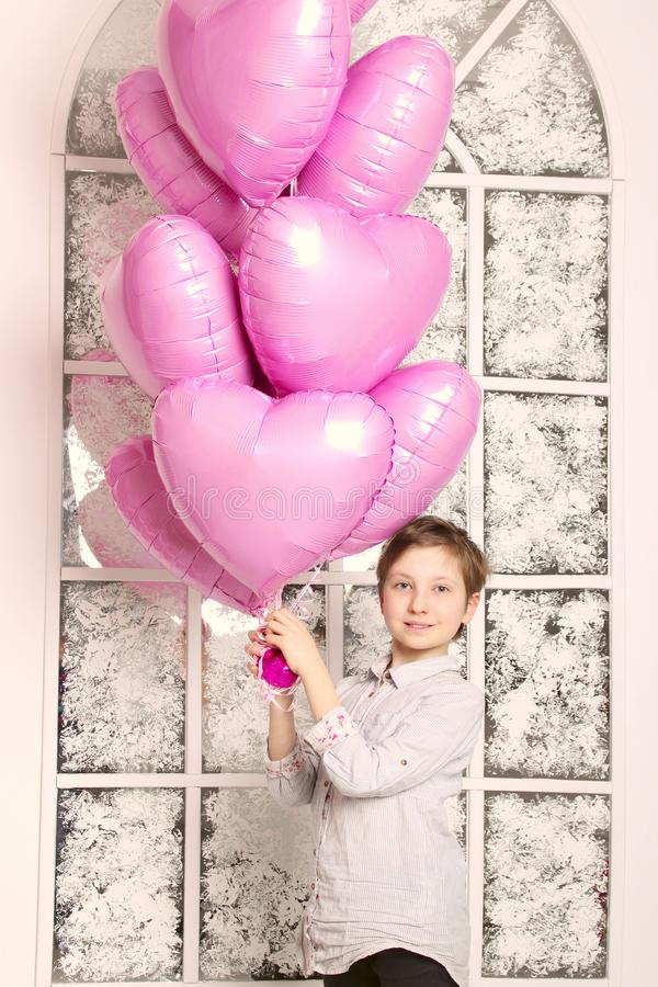 Cute Young Caucasian Girl Holding A Big Pink Balloons. stock photos