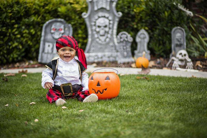 Cute young child in a halloween costume ready to trick or treat. A cute smiling little boy in his halloween costume ready to go trick or treating in the stock images