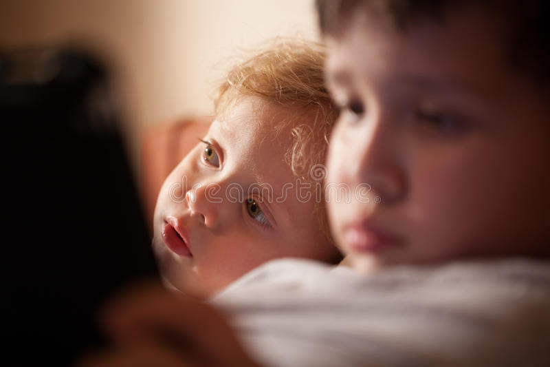Cute young child relaxing with his brother stock photos