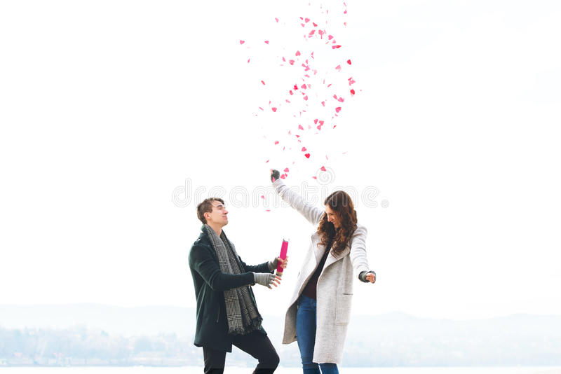 Cute young couple in love, hearts falling stock images