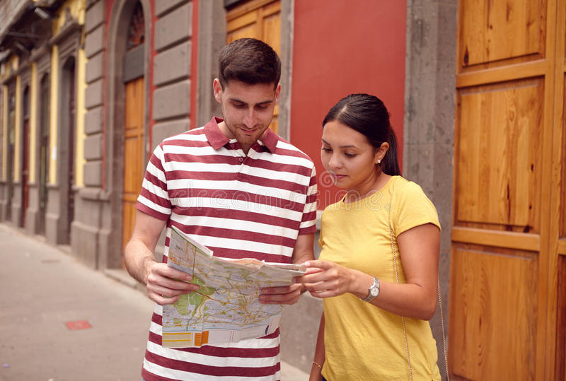 Cute young couple studying a map stock image
