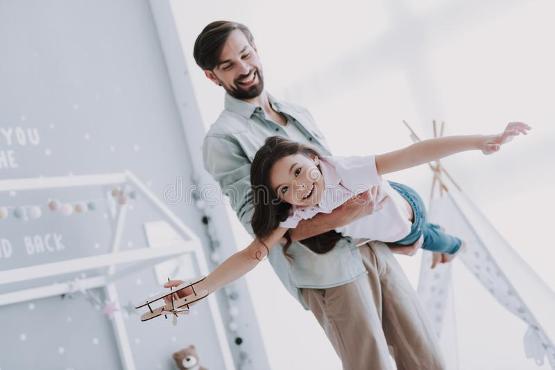 Cute Young Daughter on Playing with Handsome Dad. Cute Young Daughter on Piggy Back Ride with Dad. Happy Father`s Day Concept. Father with Daughter Spending Time royalty free stock photos