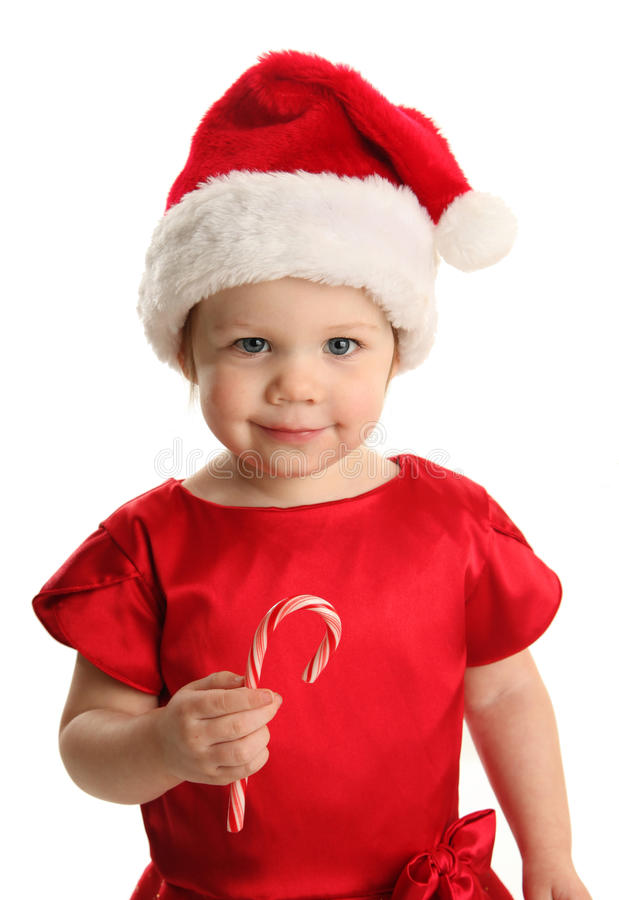 Cute young female child with a holiday candy cane royalty free stock image