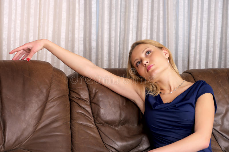 Cute young female sitting on royalty free stock photos