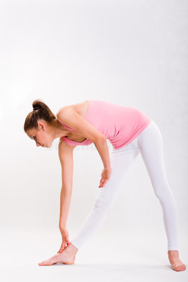 Cute young fitnes girl doing exercises. stock photo