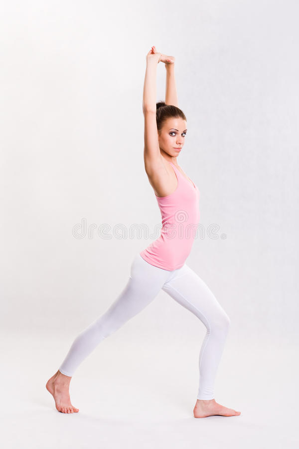 Cute young fitnes girl doing exercises. stock photos