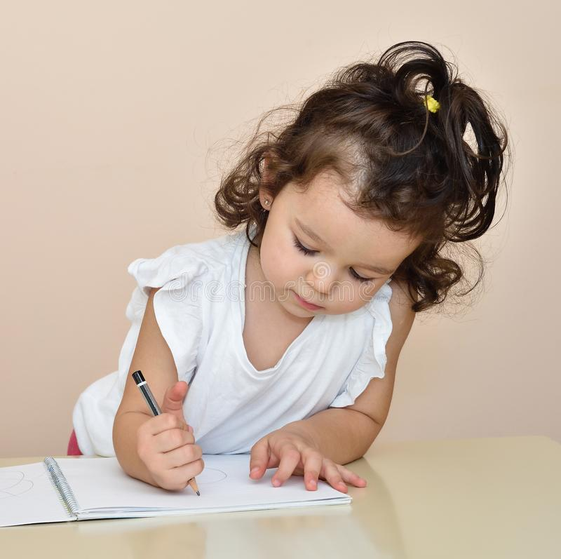 Cute young girl drawing royalty free stock photos