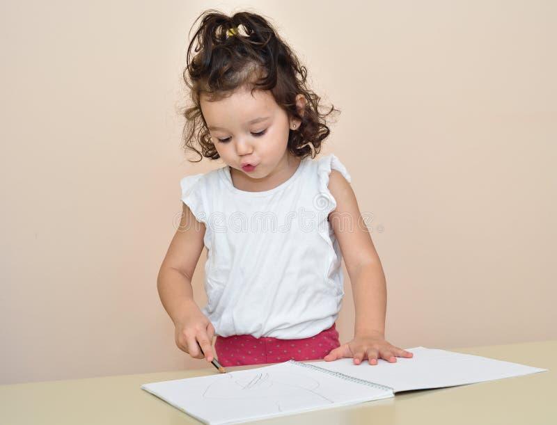 Cute young girl drawing stock photos