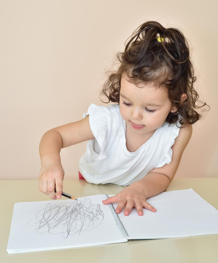 Cute young girl drawing stock image
