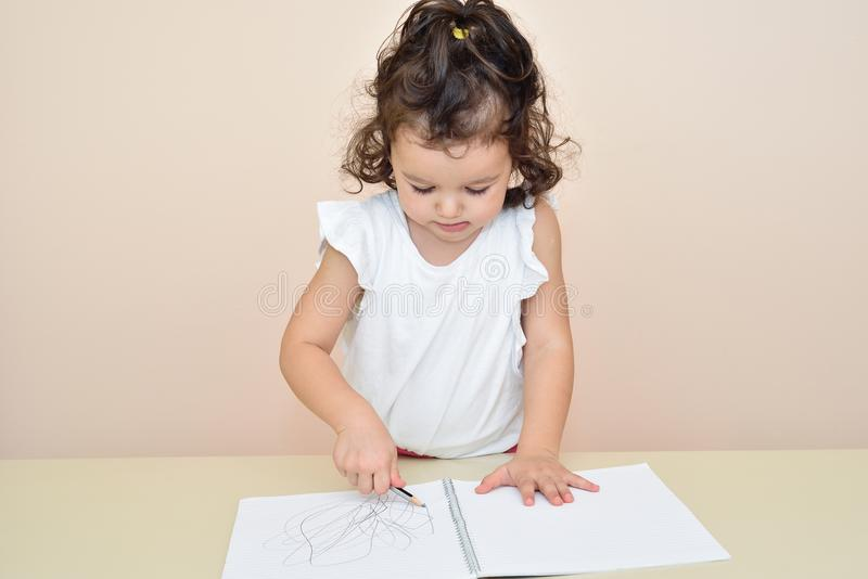 Cute young girl drawing royalty free stock images