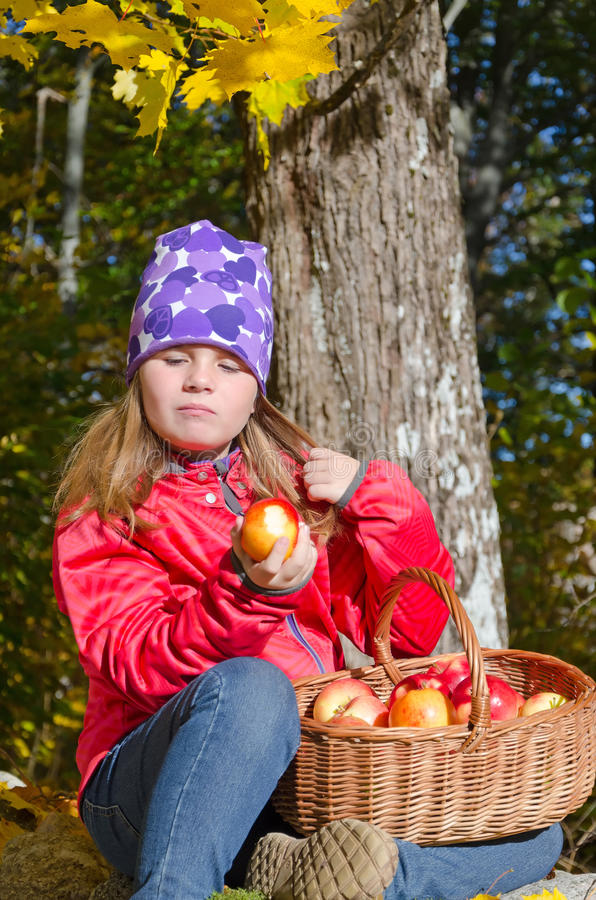 Download Cute Young Girl Eating Fresh Autumn Apples Stock Photo - Image: 35722940