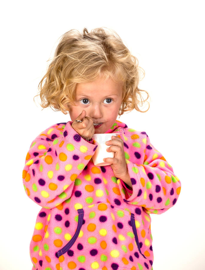 Cute young girl eating royalty free stock photography