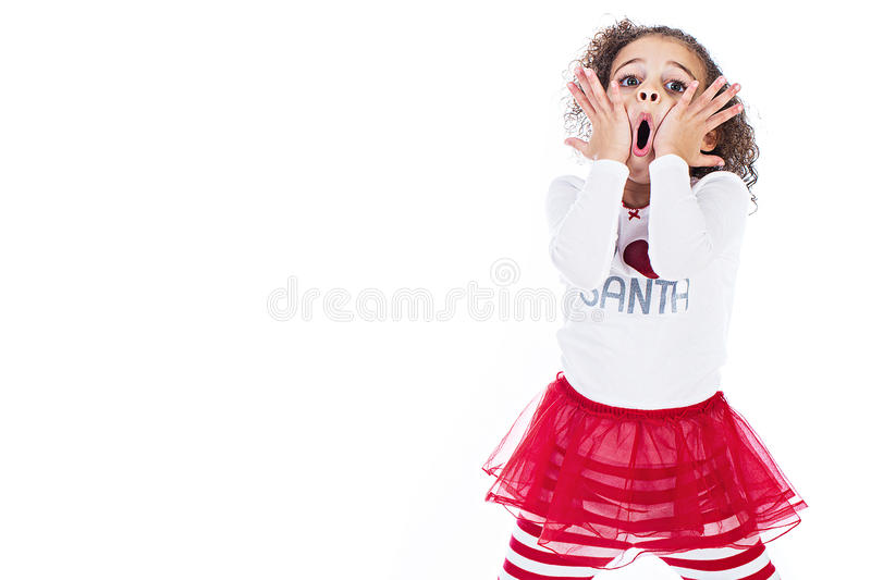 Cute young girl with an expression of surprise stock photography