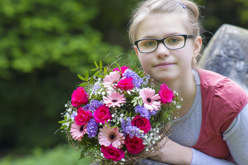 Cute young girl with flowers stock images
