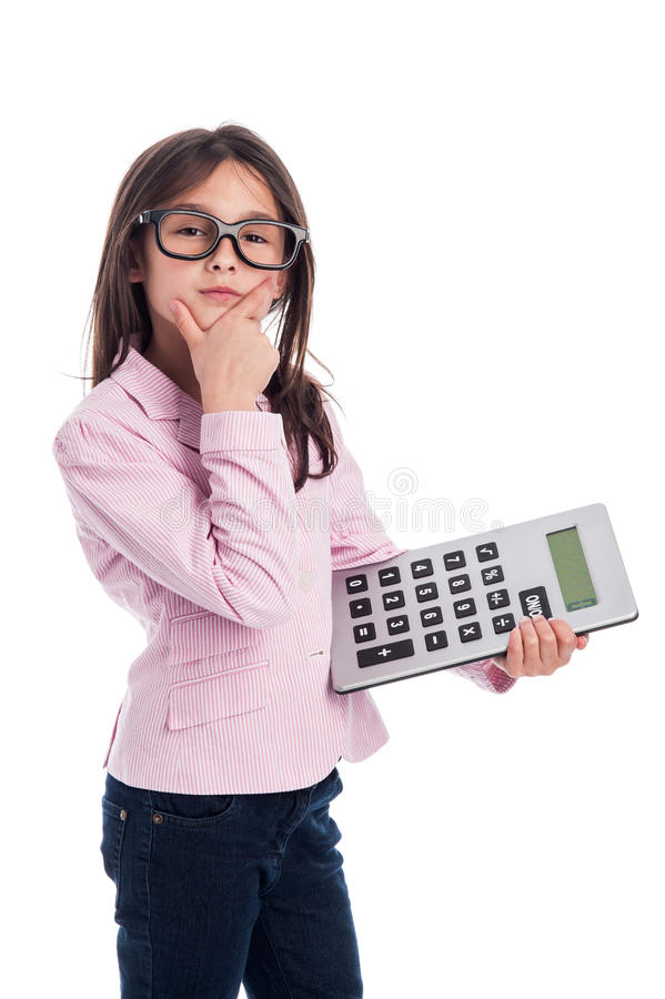 Cute Young Girl with Glasses and a Calculator. Clever girl with glasses and a calculator doing a calculation. Isolated on a studio white background stock photos