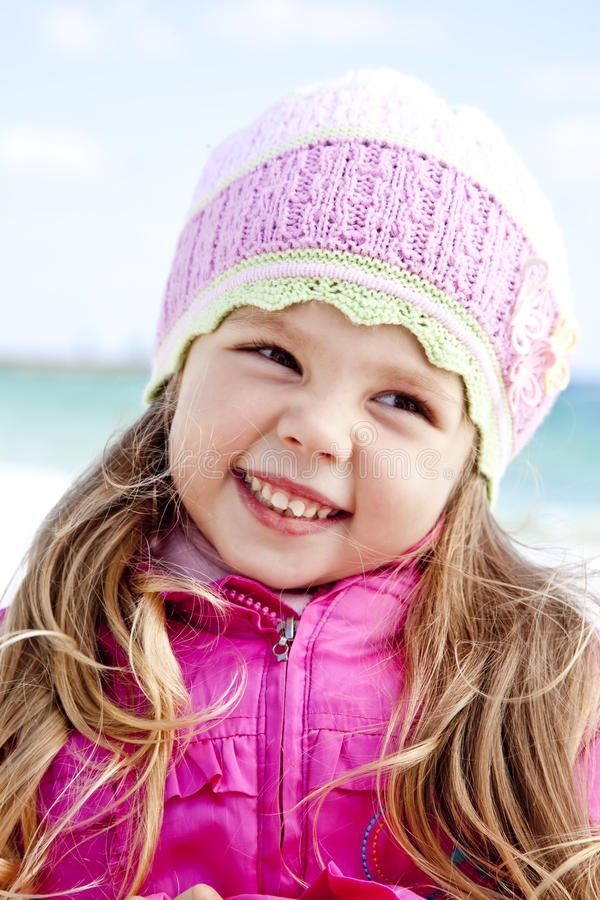 Cute young girl having fun on the beach royalty free stock photos