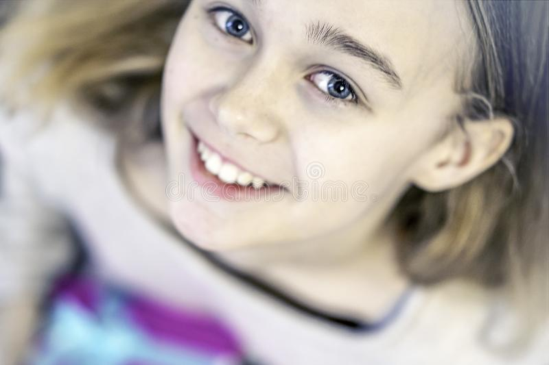 Cute young girl holding presents, smiling and looking at camera stock photos