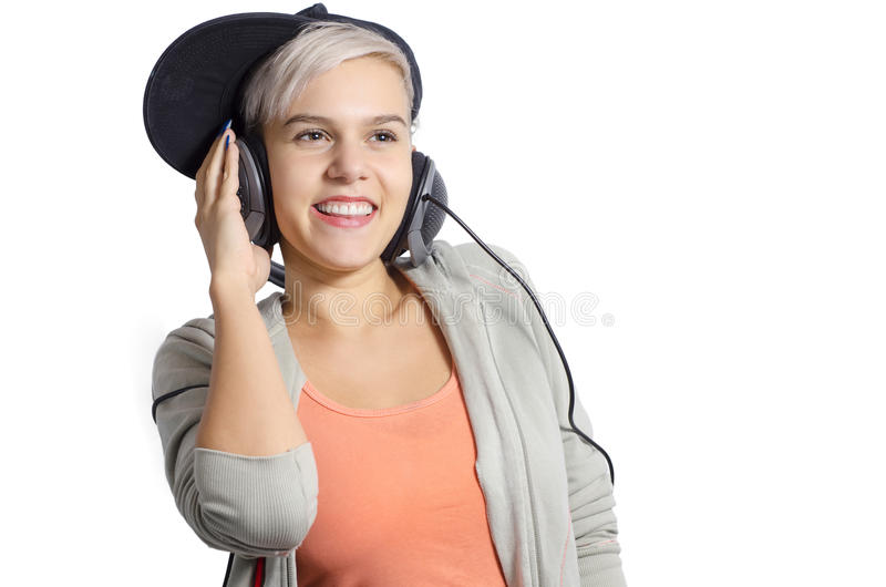 Cute young girl listening to music on headphones royalty free stock photo