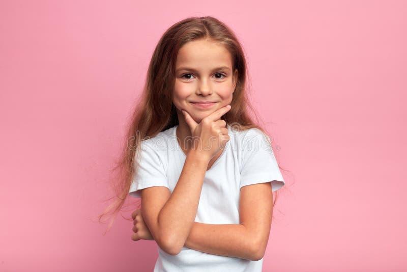 Cute young girl with long fair hair having a great idea stock photos