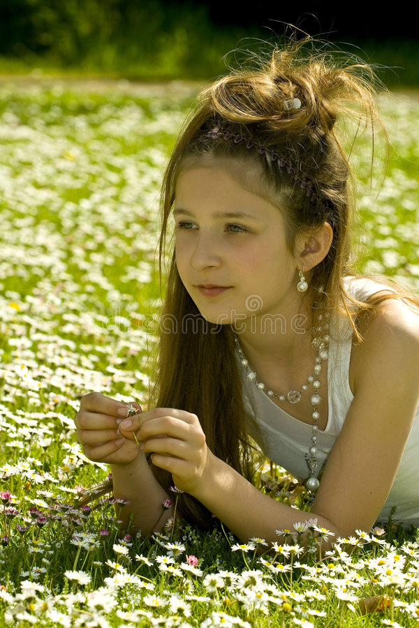 cute young girl picking flowers stock images image 7251364. Black Bedroom Furniture Sets. Home Design Ideas