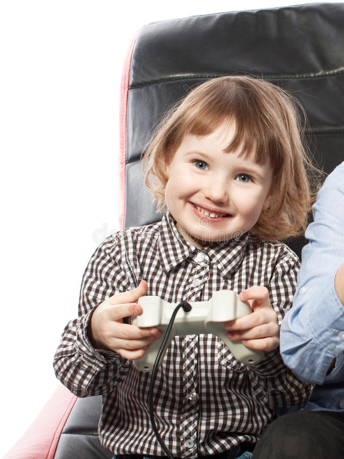Cute Young Girl Playing Videogame Stock Image