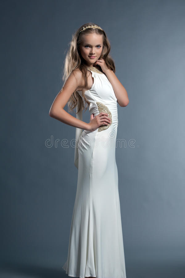 Cute young girl posing in white dress and tiara stock images