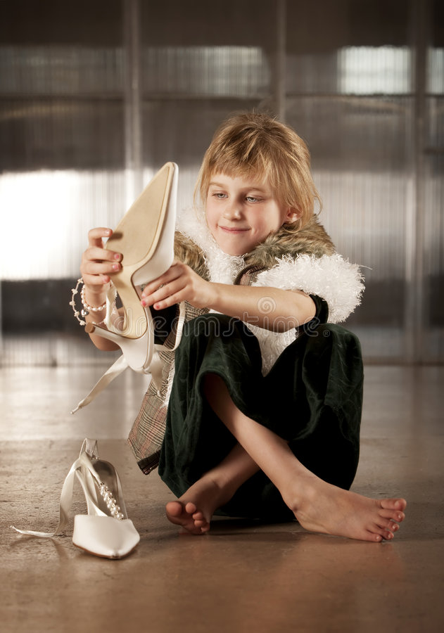 Download Cute Young Girl Putting On Adult Shoe Stock Image - Image: 8595969
