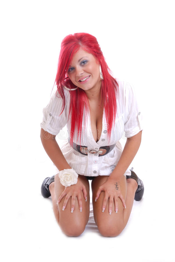 Cute young girl with red hair kneeling isolated