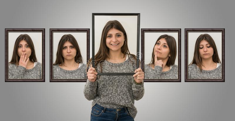 Cute young girl shows various facial expressions as if she were inside a picture. Concept of different emotions stock photos