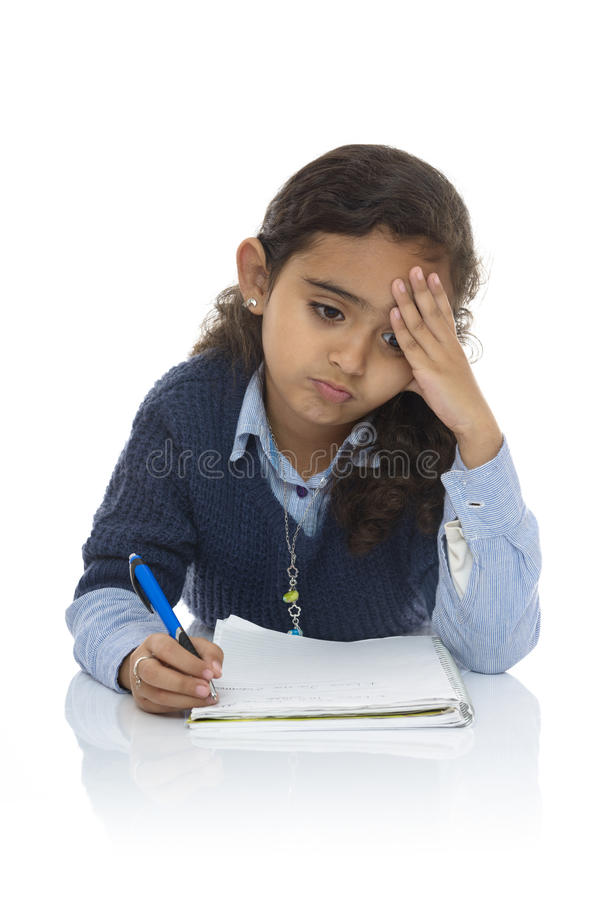 Cute Young Girl Studying Hard royalty free stock images