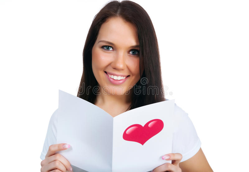Cute young girl with a Valentine's card stock photos