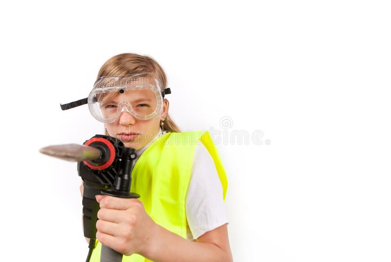 Cute young girl wearing safety vest and safety goggles royalty free stock photos