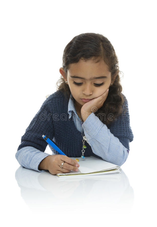 Cute Young Girl Writing. Isolated on White Background stock photos